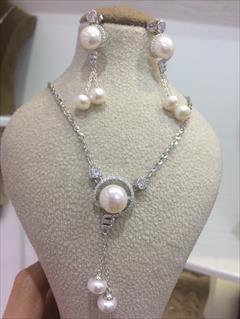 buy-sell antiques old-jewelry نیمست های نقره مروارید زیورآلات الماسین